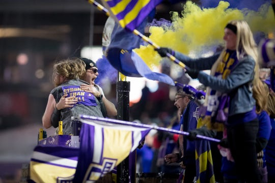 Louisville City FC fans celebrate after a goal in Saturday's win over Bethlehem in the playoffs.