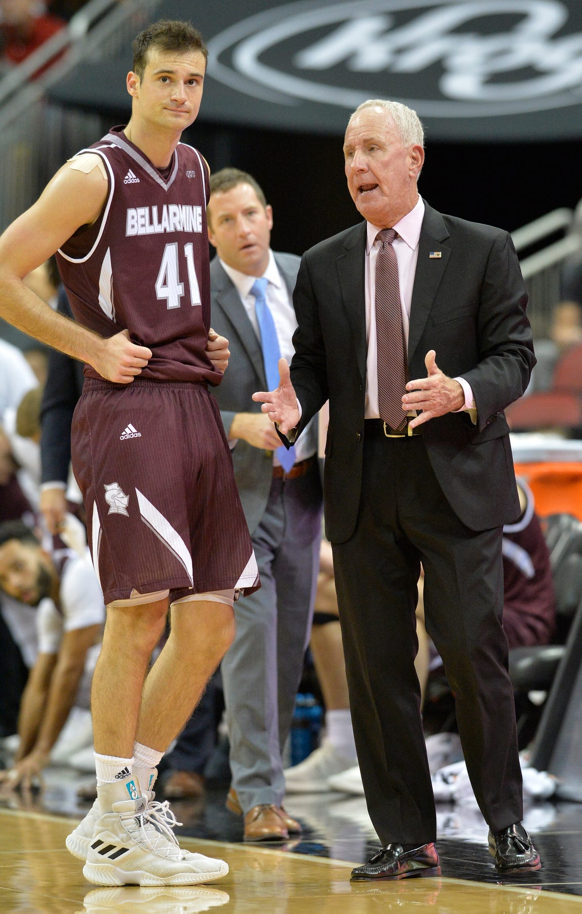 Bellarmine head coach Scott Davenport, right, talks with forward Adam Eberhard (41) during the second half of an exhibition game against Louisville on Sunday, Oct. 28, 2018. Louisville won 71-60.