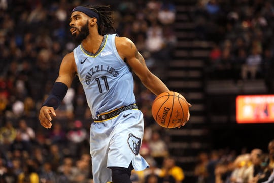 Memphis Grizzlies guard Mike Conley brings the ball up court against the Phoenix Suns during their game at FedExForum on Saturday, Oct. 27, 2018.