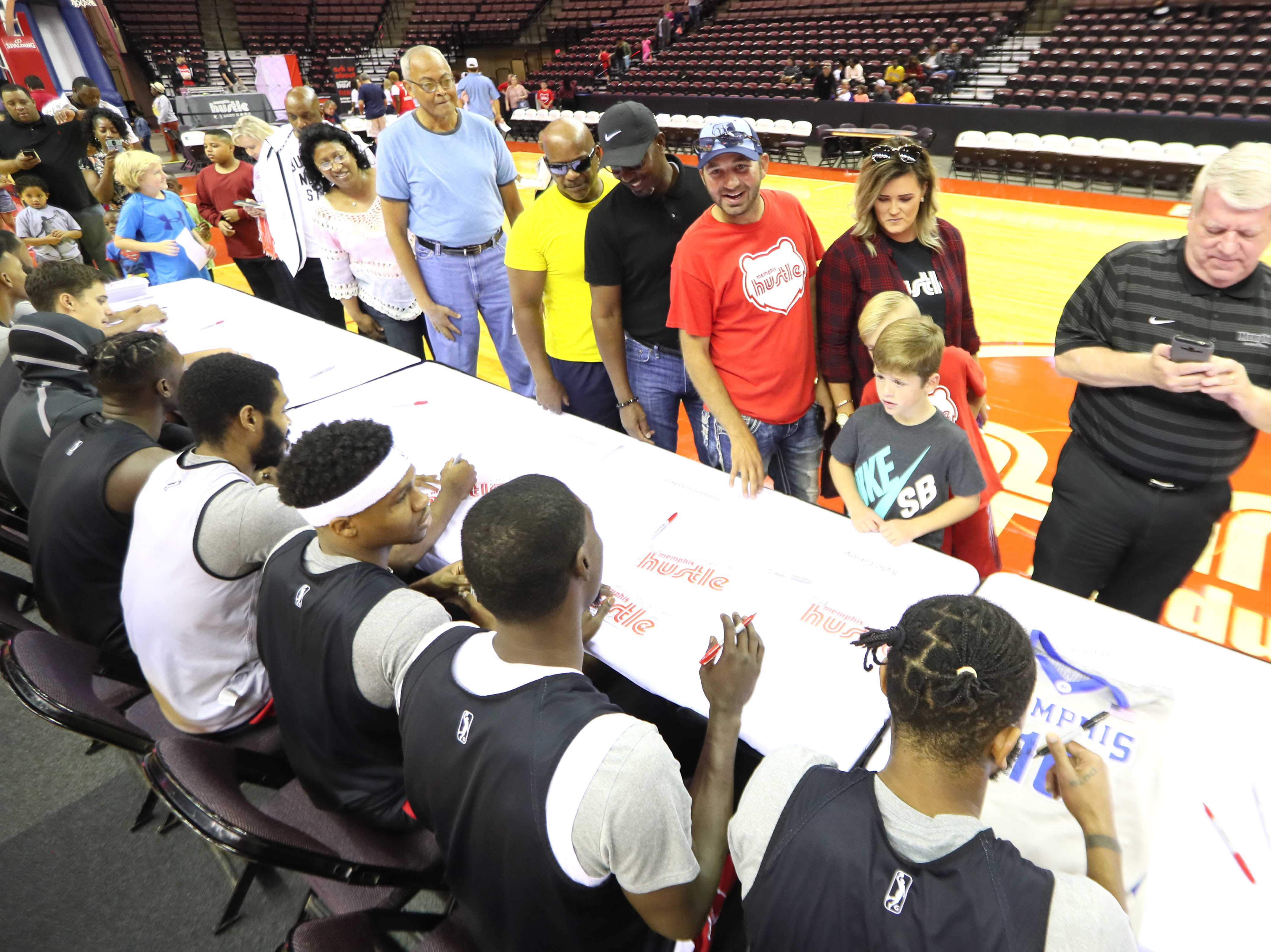 Memphis Hustle players sign autographs for fans as they host Family Fun Day at the Landers Center on Sunday, Oct. 28, 2018.