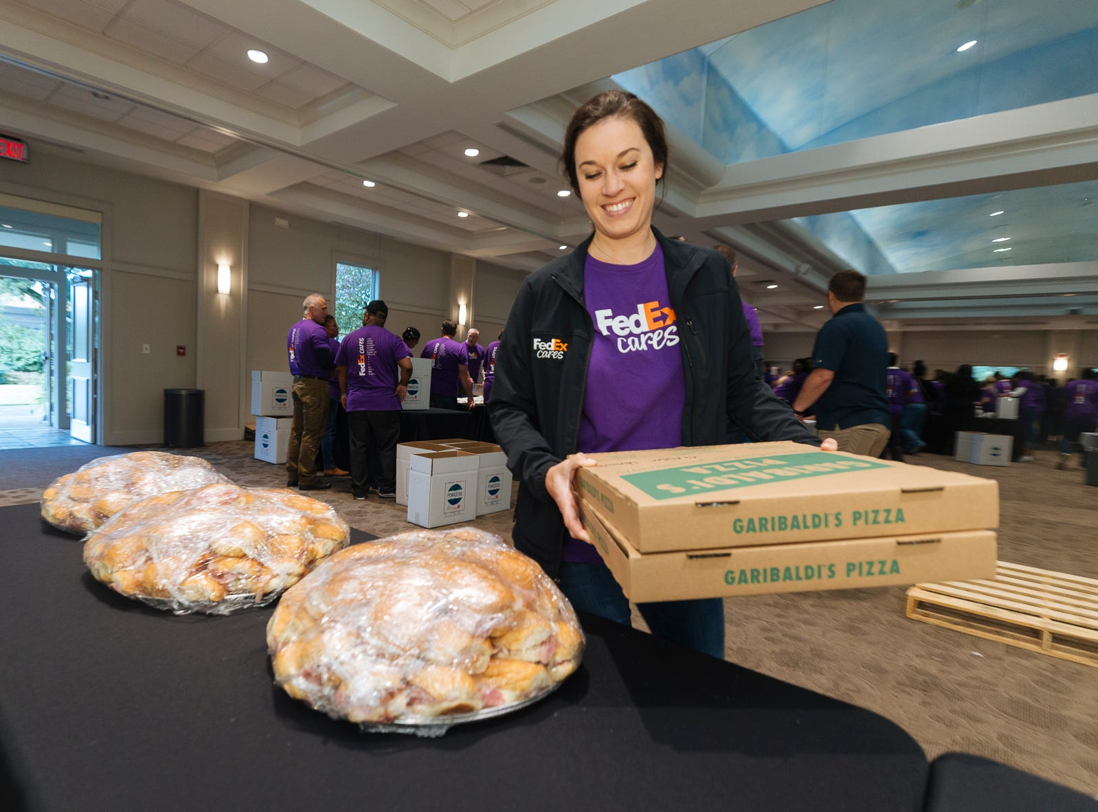FedEx volunteers prepare lunch for fellow team members nearing the end of the assembly o 3,600 hygiene kits for relief from Hurricanes Florence and  Michael.