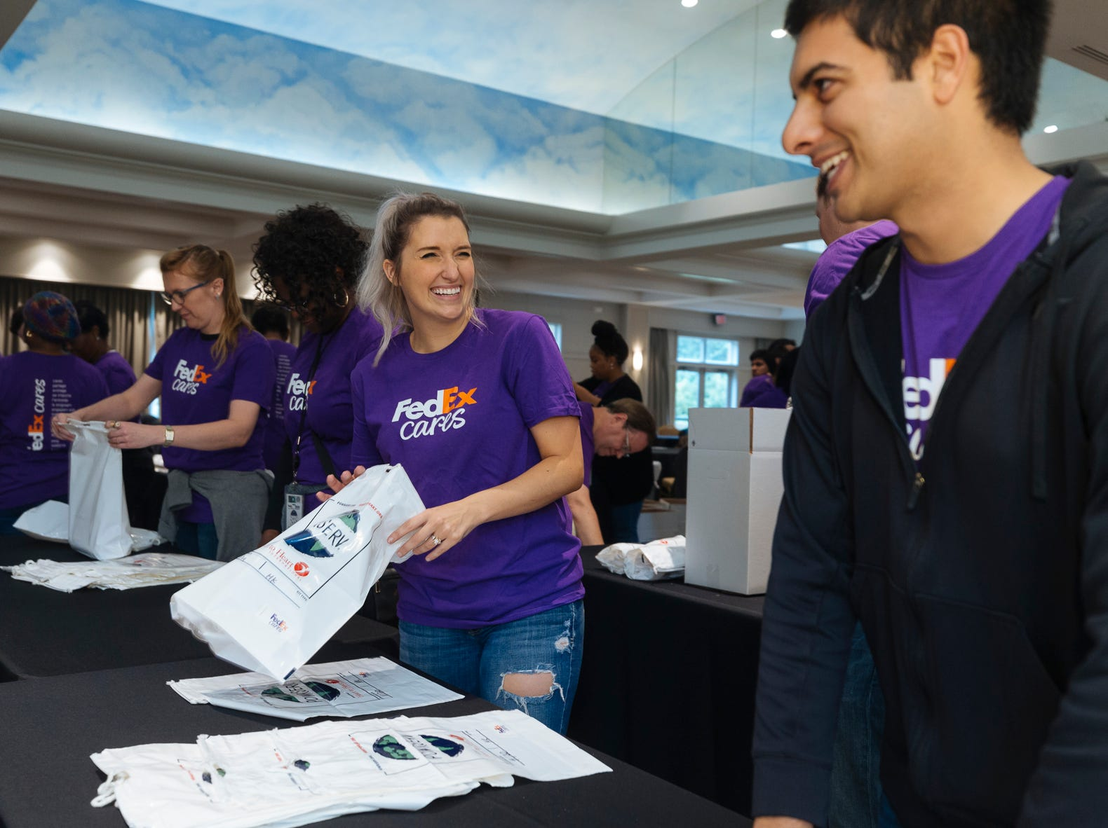 More than 100 FedEx volunteers collaborate with Heart to Heart International assembling 3,600 hygiene kits at the Memphis Botanic Gardens on Friday, Oct. 26, 2018. The kits will be used to provide health relief for victims from the devastation of Hurricanes Florence and Michael.
