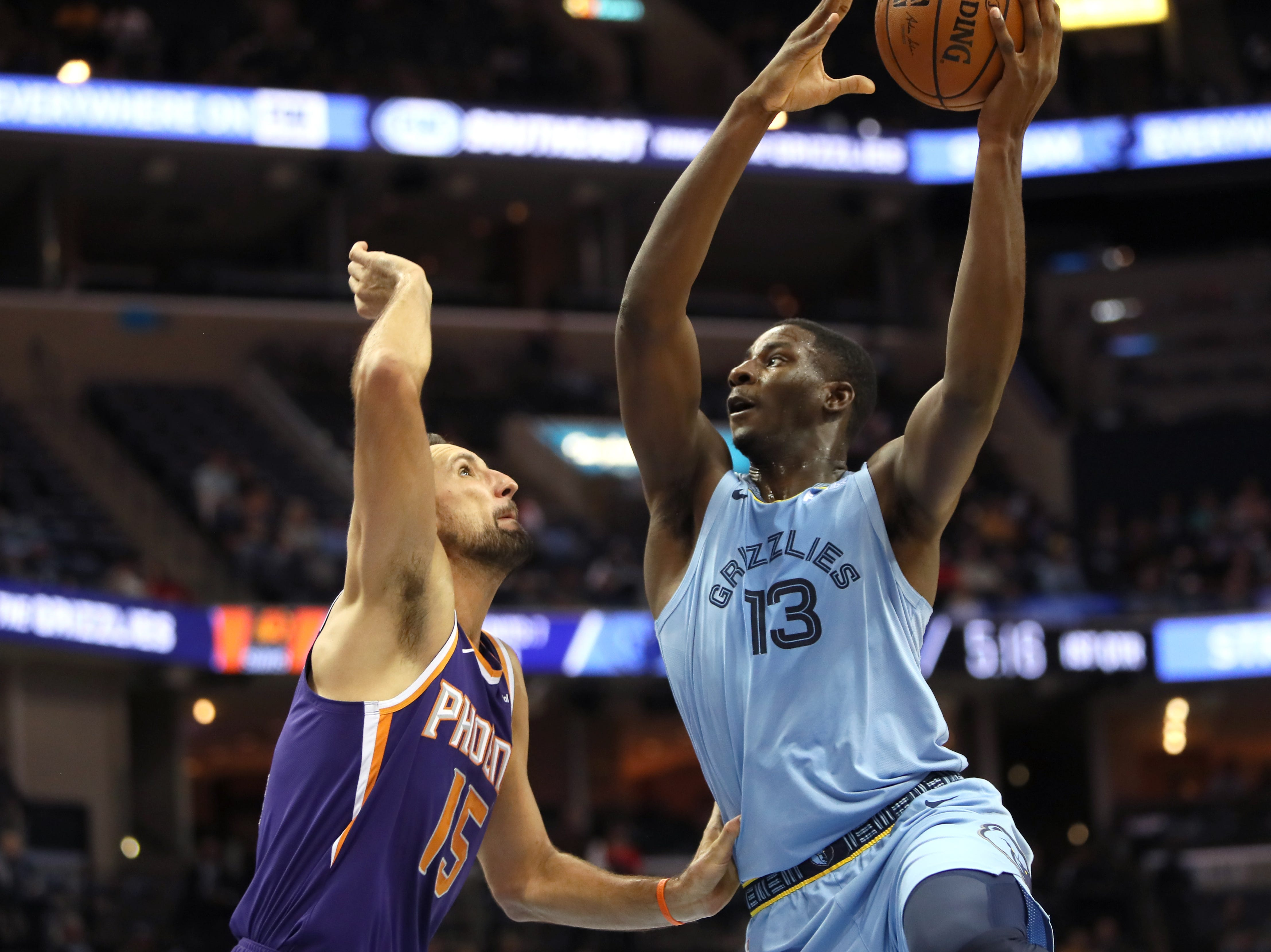 Memphis Grizzlies forward Jaren Jackson Jr. puts up a shot against Phoenix Suns forward Ryan Anderson during their game at FedExForum on Saturday, Oct. 27, 2018.