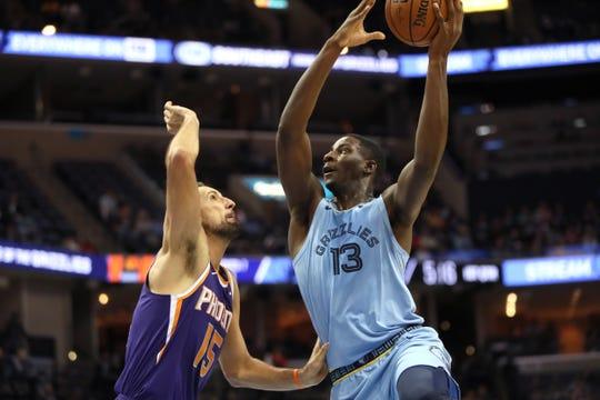 Memphis Grizzlies forward Jaren Jackson Jr. puts up a shot against Phoenix Suns forward Ryan Anderson during their game at FedExForum on Saturday, Oct. 27, 2018.