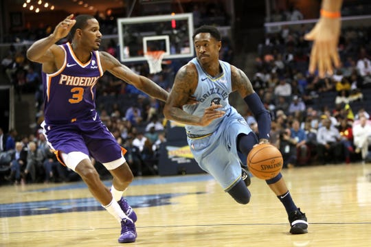 Memphis Grizzlies guard MarShon Brooks drives past Phoenix Suns forward Trevor Ariza during their game at FedExForum on Saturday, Oct. 27, 2018.