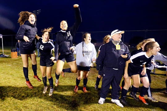 Houston's Parker Gelinas (12) and her teammates celebrate in the final seconds of their Class AAA soccer championship match against Collierville Saturday, Oct. 27, 2018, in Murfreesboro, Tenn.