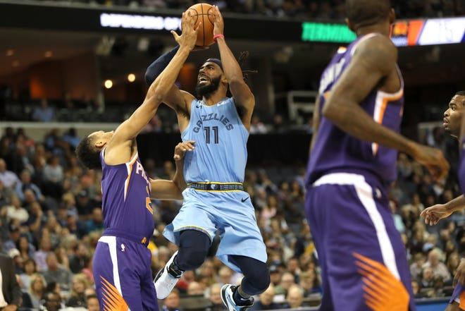 Memphis Grizzlies guard Mike Conley Jr. shoots over Phoenix Suns guard Elie Okobo during their game at FedExForum on Saturday, Oct. 27, 2018.