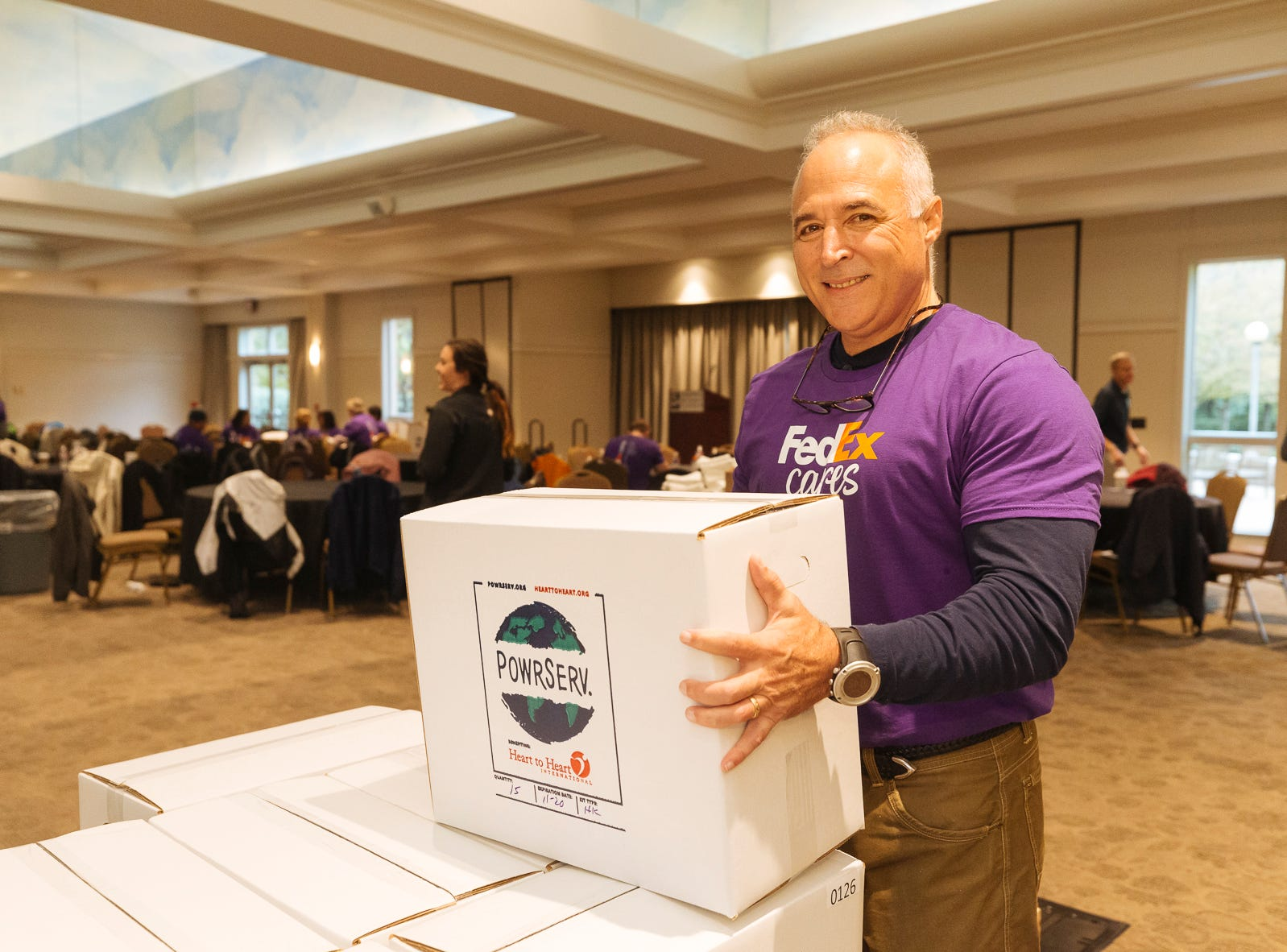 David Hankins joins more than 100 FedEx volunteers collaborate with Heart to Heart International assembling 3,600 hygiene kits at the Memphis Botanic Gardens on Friday, Oct. 26, 2018. The kits will be used to provide health relief for victims from the devastation of Hurricanes Florence and Michael.