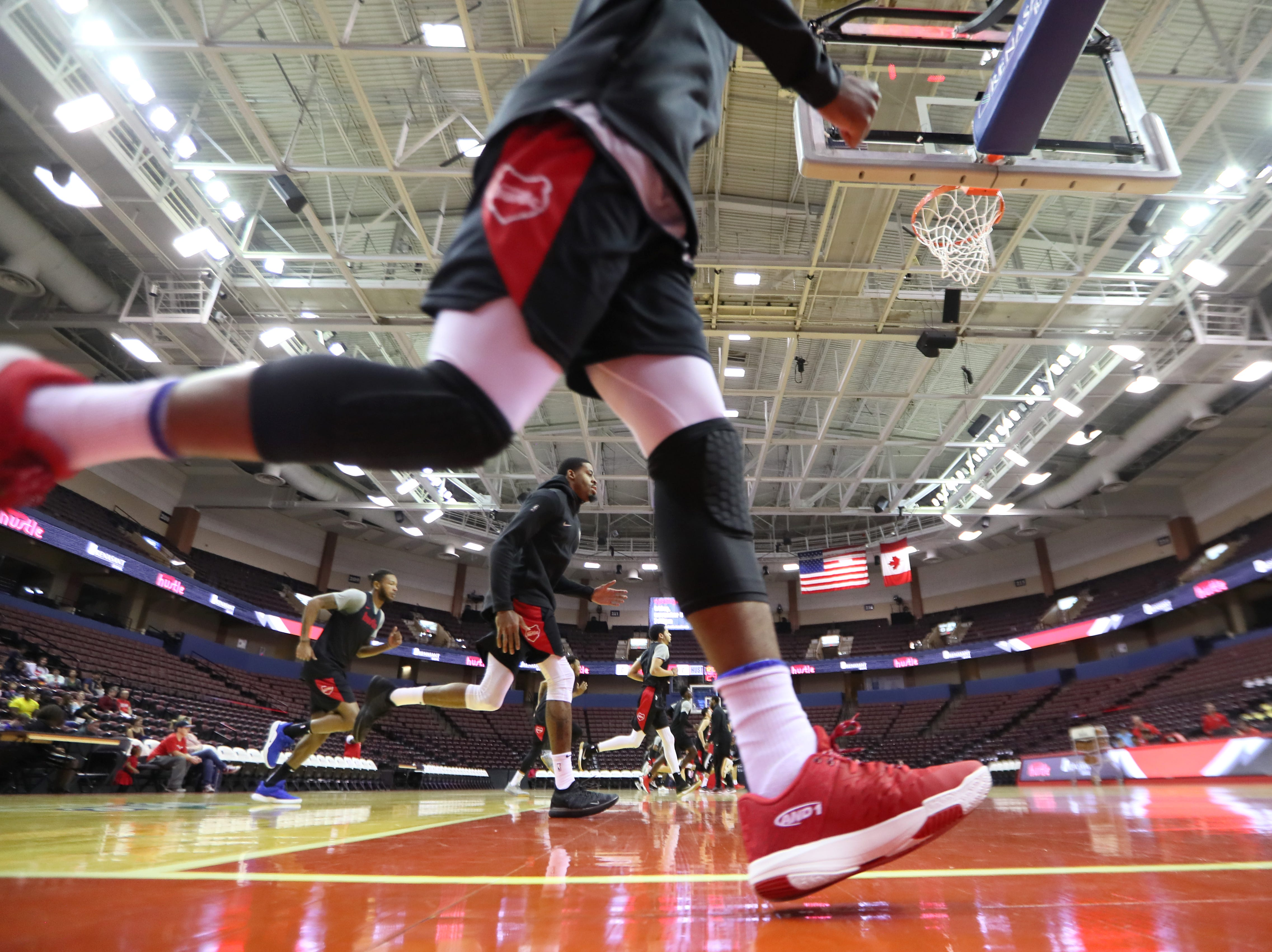 Memphis Hustle players warm up before playing a scrimmage during Family Fun Day at the Landers Center on Sunday, Oct. 28, 2018.