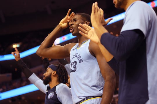 Memphis Grizzlies forward Jaren Jackson Jr. celebrates from the bench as his team goes on to beat the Phoenix Suns at FedExForum on Saturday, Oct. 27, 2018.