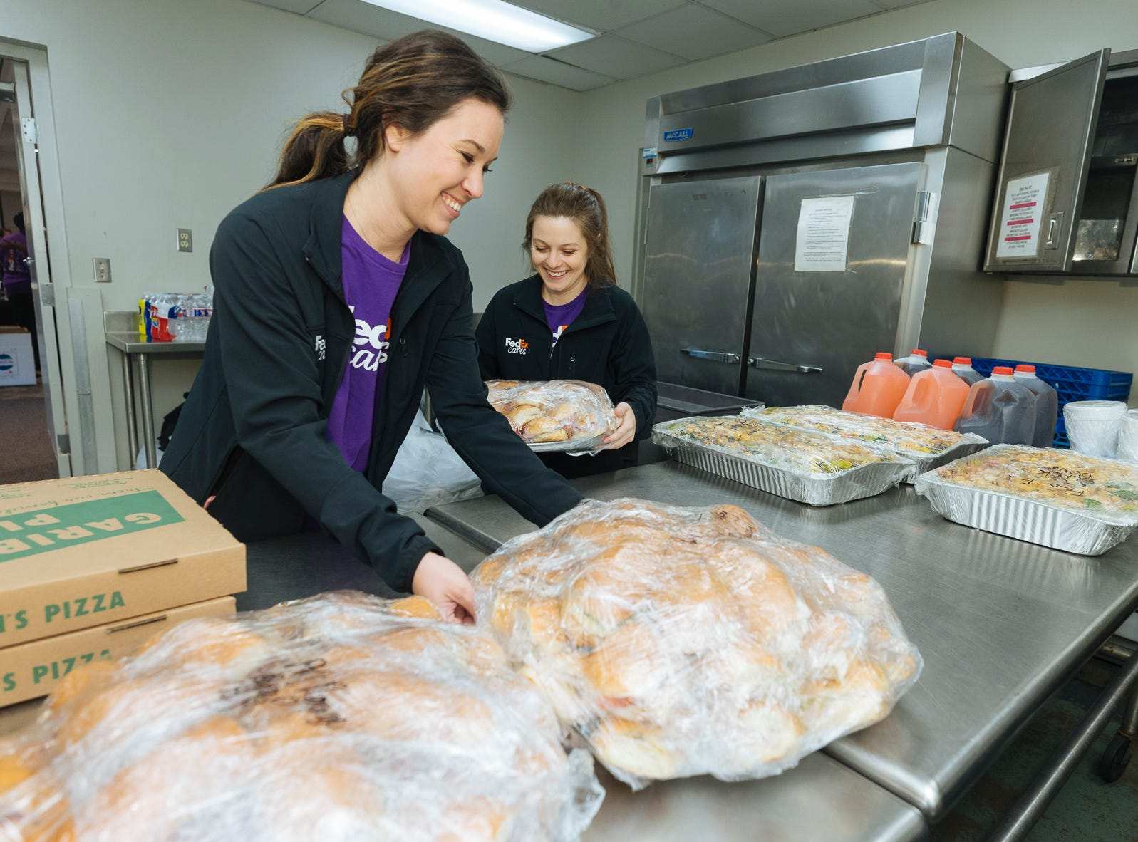 FedEx volunteers prepare lunch for fellow team members nearing the end of the assembly o 3,600 hygiene kits for relief from Hurricanes Florence and  Michael
