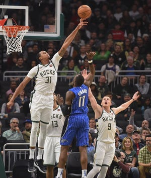 Bucks forward John Henson rejects the shot of Magic forward Amile Jefferson during the second quarter Saturday night.