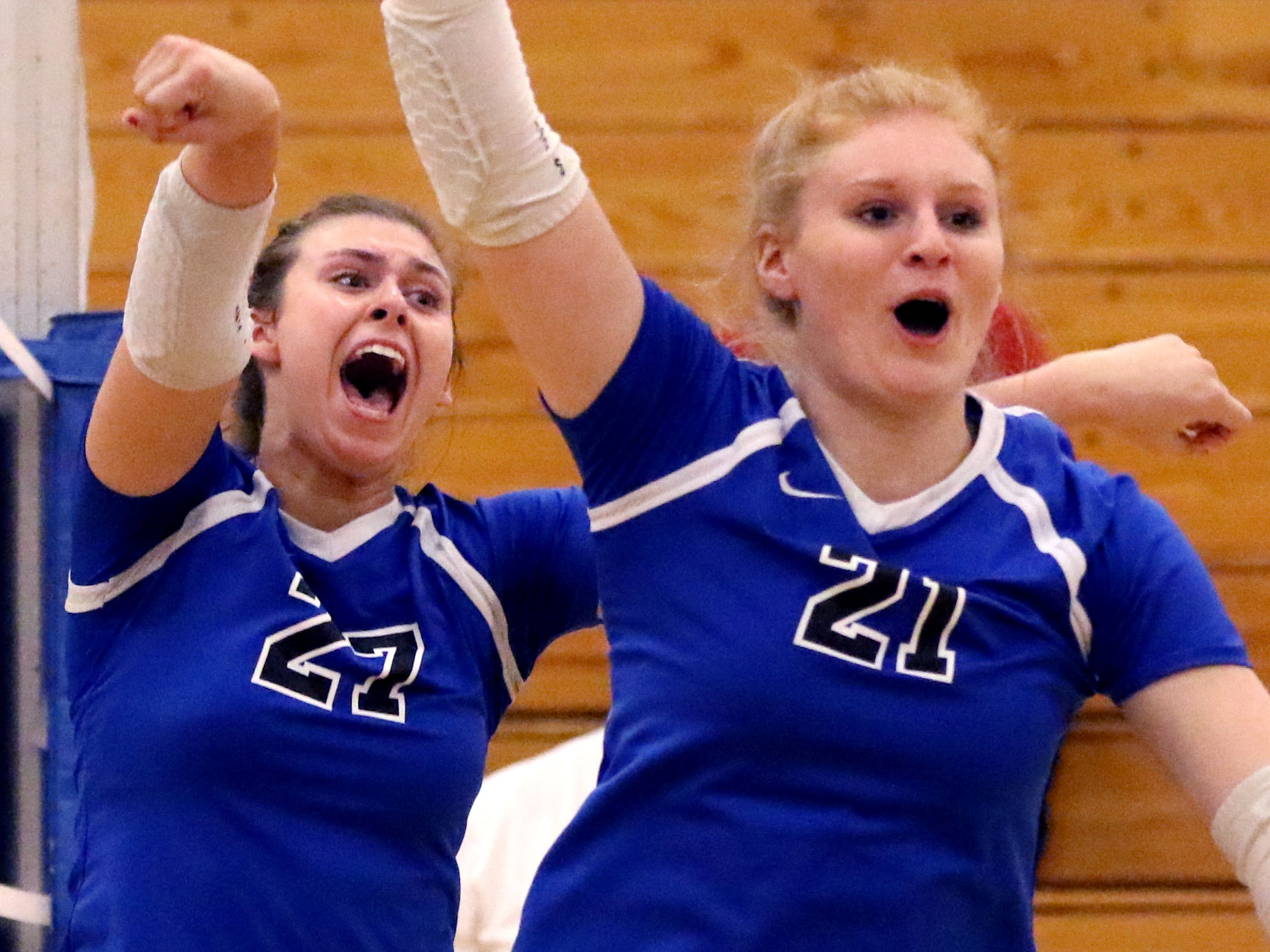 Waukesha West's Lauren Dabey (left) and Anna Nerad celebrate a point against Mukwonago during a WIAA Division 1 sectional final at Kettle Moraine on Oct. 27. The Wolverines defeated Mukwonago in four sets to advance to the state tournament.