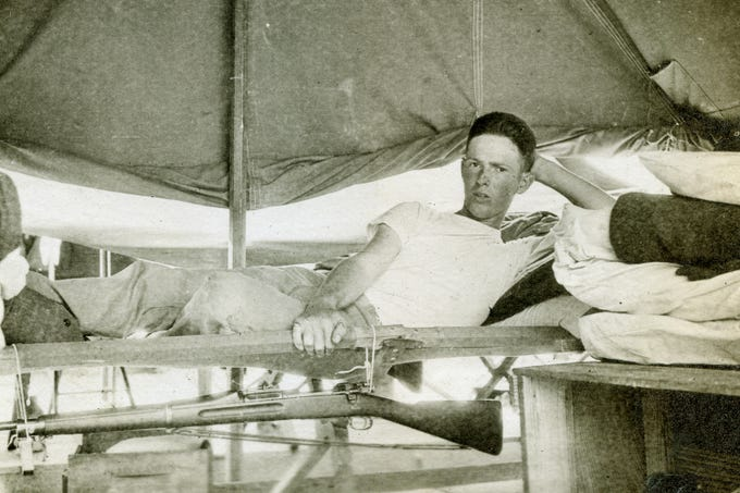 Harold Reilly in his first barracks at Paris Island, SC. Reilly left Marquette University in May 1917 to enlist in the U.S. Marines where he was assigned to the 81st Co., 6th Machine Gun Battalion. His unit arrived in France on Dec. 28, 1917. In September 1918, he was wounded and hospitalized until Oct. 31 and returned to his unit. On Nov. 2 Reilly died by artillery, nine days before the end of World War 1. Reilly's parents did not learn of their loss until Nov. 20.