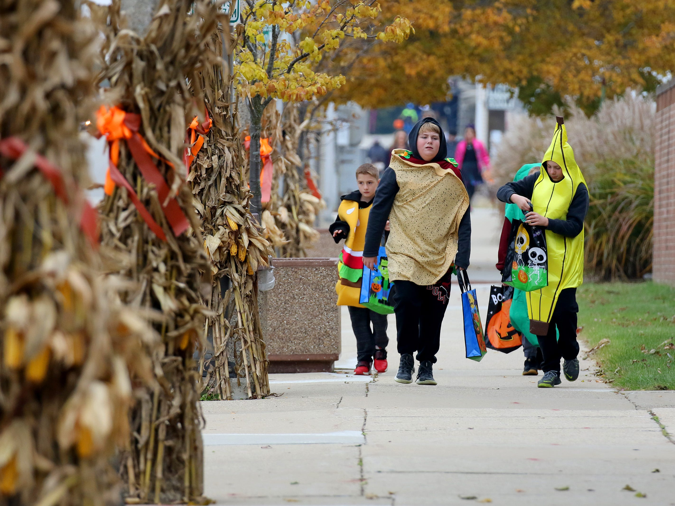 Children head along Milwaukee Avenue during the South Milwaukee Downtown Trick or Treating on Oct. 27.