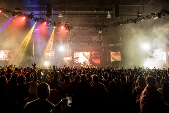 While the lobby of the Wisconsin Center felt pretty formal for an event like this, the main venue itself served the fest well. The carpet was ripped out, and the main stage was accompanied by seven large video screens, an arsenal of lights. and thumping sound.