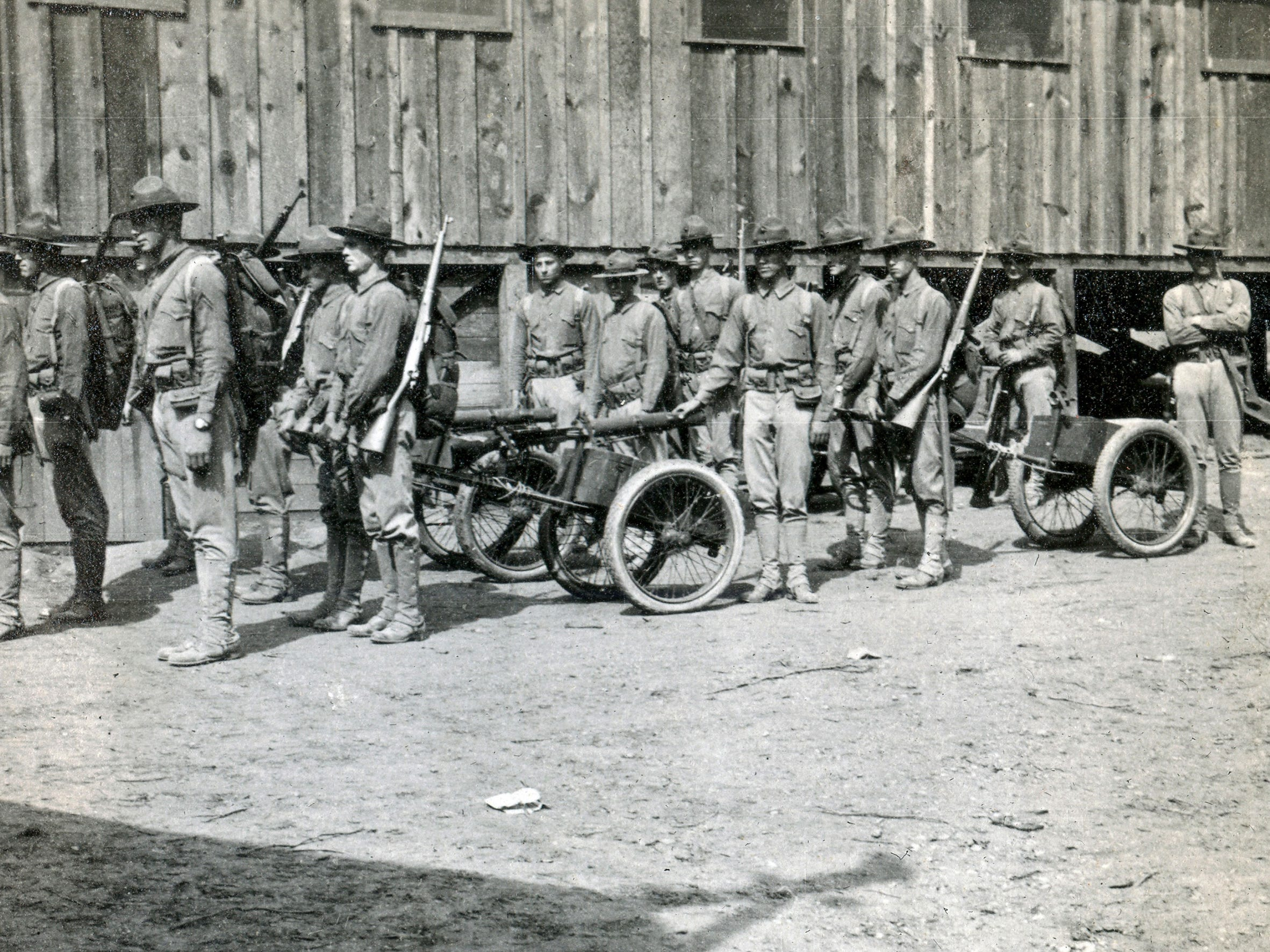Pulling gun and ammunition carriages, two squads ready to march in full gear at Quantico, VA. Harold Reilly left Marquette University in May 1917 to enlist in the U.S. Marines where he was assigned to the 81st Co., 6th Machine Gun Battalion. His unit arrived in France on Dec. 28, 1917. In September 1918, he was wounded and hospitalized until Oct. 31 and returned to his unit. On Nov. 2 Reilly died by artillery, nine days before the end of World War 1. Reilly's parents did not learn of their loss until Nov. 20.