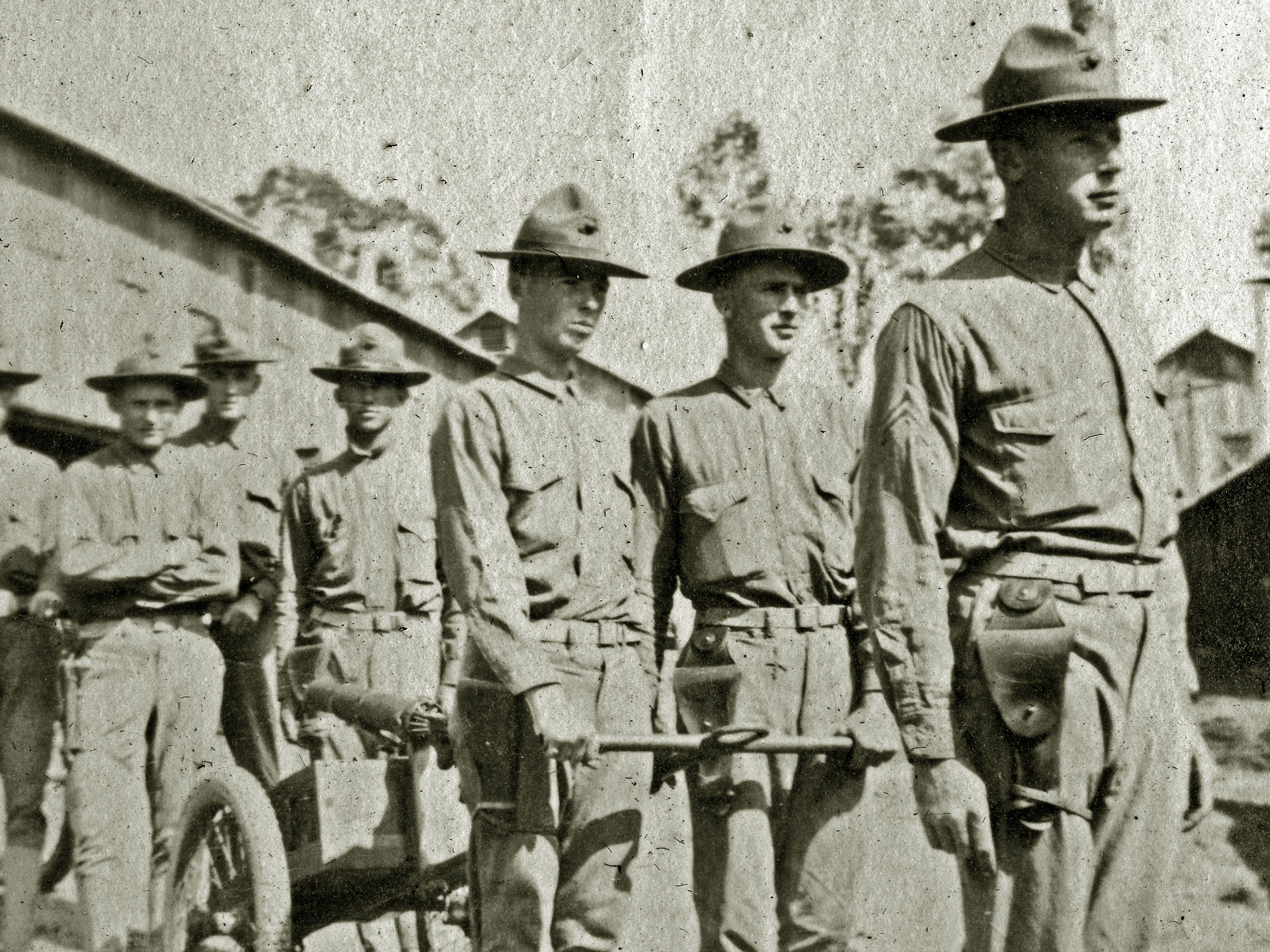 Harold Reilly (third from right) left Marquette University in May 1917 to enlist in the U.S. Marines where he was assigned to the 81st Co., 6th Machine Gun Battalion. His unit arrived in France on Dec. 28, 1917. In September 1918, he was wounded and hospitalized until Oct. 31 and returned to his unit. On Nov. 2 Reilly died by artillery, nine days before the end of World War 1. Reilly's parents did not learn of their loss until Nov. 20.