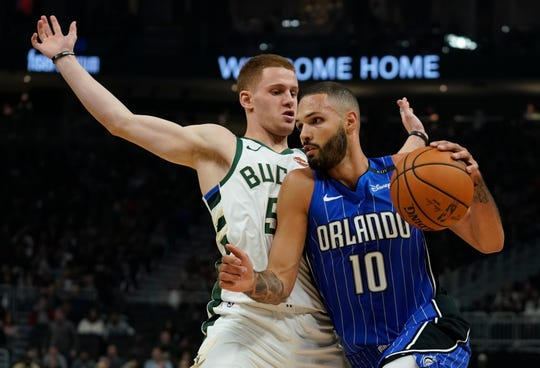 Bucks rookie guard Donte DiVincenzo tries to prevent the Magic's Evan Fournier from getting to the basket at Fiserv Forum.