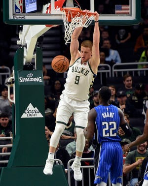 Bucks first-round pick Donte DiVincenzo throws home two of his career-high 15 points against the Magic on Saturday night at Fiserv Forum.
