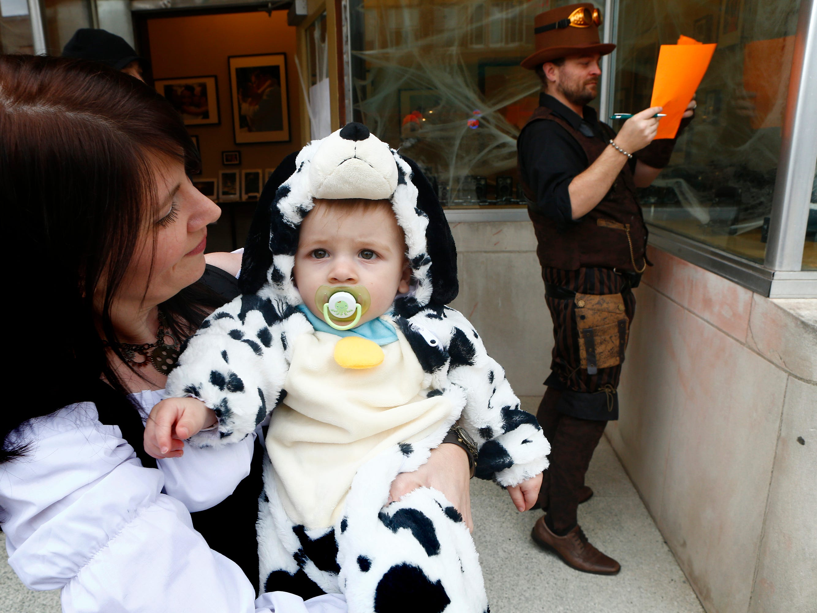 Braiden Krejci joined his parents Stacy and John Krejci as they handed out treats at Studio 919 during the South Milwaukee Downtown Trick or Treating on Oct. 27.