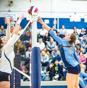Randolph's Alexis Kemp (8) and the Wolfpack's Liz Gialanella (10) rach for the ball at the 2018 Morris County Volleyball Tournament Finals between West Morris and Randolph at Randolph High in Randolph, October 27, 2018.