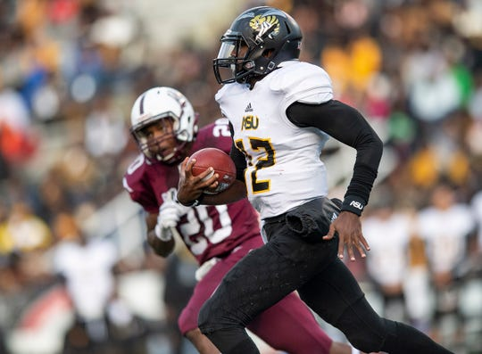 Alabama State University quarterback KHA'Darris Davis (12)  carries the ball against ]Alabama A&M  at Legion Field in Birmingham, Ala., during the Magic City Classic on Saturday October 27, 2018.