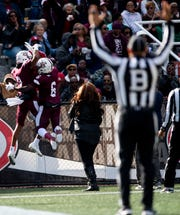 Alabama A&M wide receiver Nathaniel Dell (3) and wide receiver Brian Jenkins, Jr., (6)  celebrate Dell's touchdown catch in first half action against Alabama State University at Legion Field in Birmingham, Ala., during the Magic City Classic on Saturday October 27, 2018.
