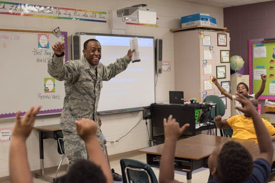 Staff Sgt. Jacaree Dezurn, Air Force Life Cycle Management Center and Junior Achievement volunteer, teaches students, Oct. 2, 2018, at Thelma S. Morris Elementary School in Montgomery, Alabama. Following the volunteer's time at the school, many emphasized the importance of this program for both the students and the local community as a whole.