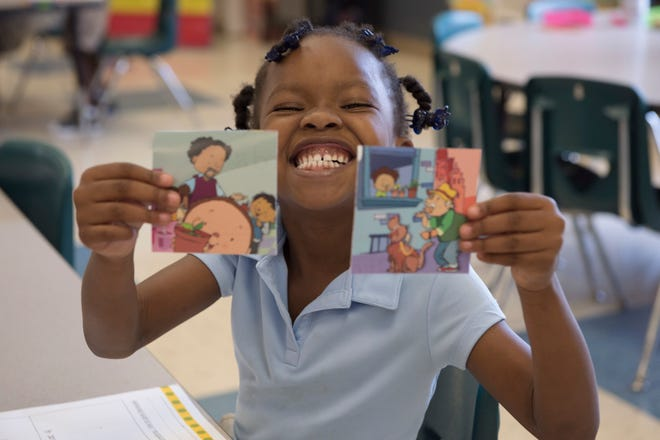 A student from Thelma S. Morris Elementary School poses for a picture, Oct. 3, 2018, in Montgomery, Alabama. Being 100 percent title one, the principal of the school said that the Junior Achievement program plays a major role in the efforts to change the negative financial trend amongst the local community.