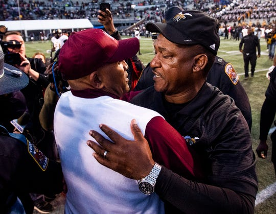 Alabama A&M head coach Connell Maynor and Alabama State University head football coach Donald  Hill-Eley hug at midfield after A&M beat ASU at Legion Field in Birmingham, Ala., during the Magic City Classic on Saturday October 27, 2018.