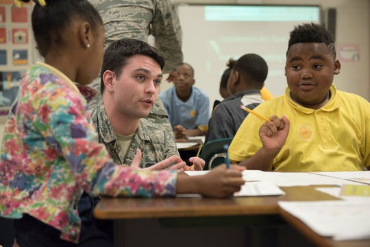 Airman 1st Class Christian Wojteczko, Air Force Life Cycle Management Center and Junior Achievement volunteer, teaches students, Oct. 2, 2018, at Thelma S. Morris Elementary School in Montgomery, Alabama. The forty-one volunteers from the Maxwell-Gunter community spent five weeks teaching the JA curriculum to students in order to increase their financial literacy.