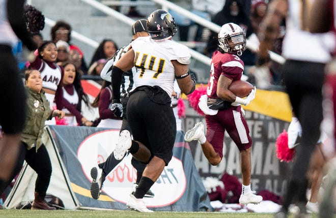Alabama A&M wide receiver Nathaniel Dell (3) scores a long touchdown late against Alabama State University at Legion Field in Birmingham, Ala., during the Magic City Classic on Saturday October 27, 2018.