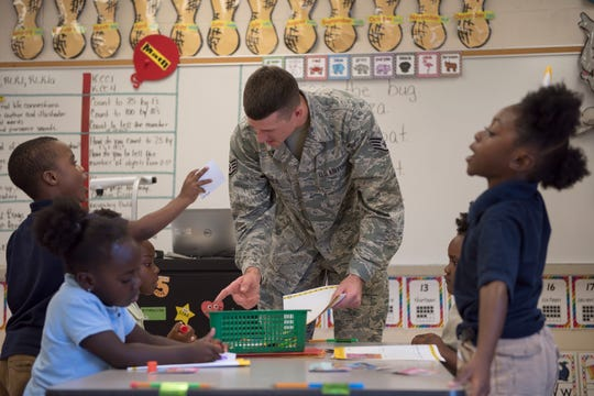 taff Sgt. Spencer Davies, Air Force Life Cycle Management Center and Junior Achievement volunteer, works with his kindergarten class, Oct. 3, 2018, at Thelma S. Morris Elementary School in Montgomery Alabama. In order to instill the Junior Achievement curriculum at an early age, T.S. Morris integrated the course into all grade levels of the school, kindergarten through fifth grade.