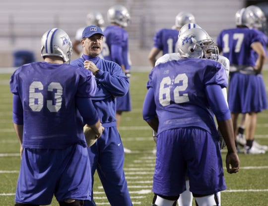 Former MTSU offensive line coach Jimmy Ray Stephens talks to his players during practice at Floyd Stadium, Dec. 15, 2006.