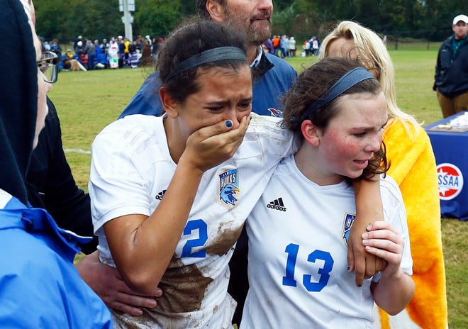 Merrol Hyde's Micayla Farmer (2) cries as she's assisted by teammate Claire Flatt (13) after their Class A soccer championship match against Signal Mountain Saturday in Murfreesboro. Signal Mountain won, 1-0.
