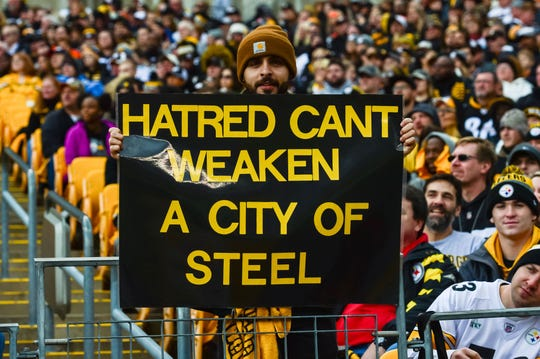 Posters at Heinz Field honor the victims of the shooting at the Tree of Life Synagogue during the first quarter against the Pittsburgh Steelers at Heinz Field.