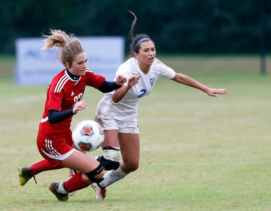 Merrol Hyde's Micayla Farmer (2) collides with Signal Mountain's Avery Madelyn (27) as they battle for the ball during their Class A soccer championship match Saturday in Murfreesboro.