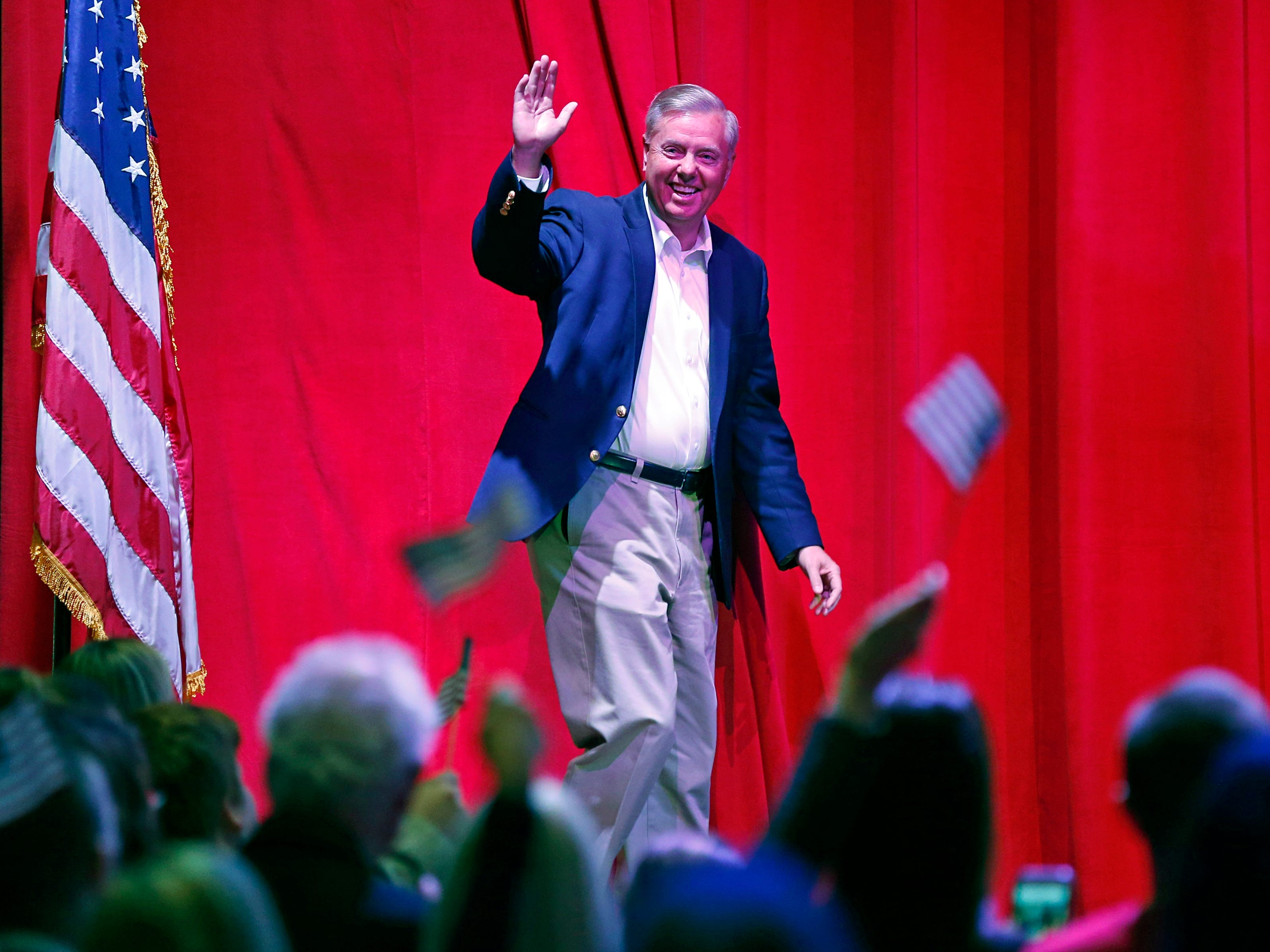 U.S. Senator Lindsey Graham waves to supporters as he's introduced during a campaign event for Republican U.S. Senate candidate Marsha Blackburn Sunday, Oct. 28, 2018, in Nashville, Tenn.