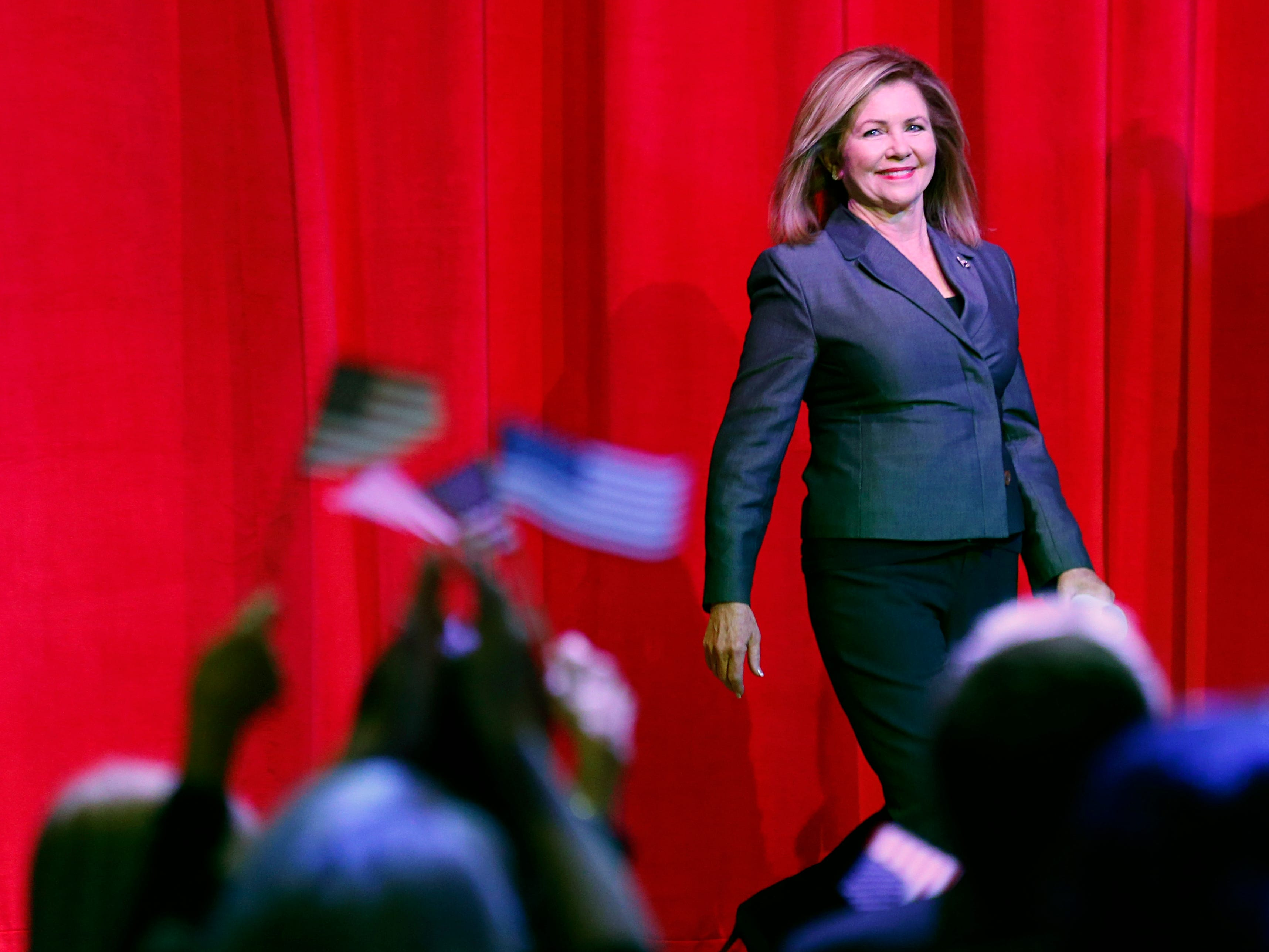 Flags wave as Republican U.S. Senate candidate Marsha Blackburn is introduced during a campaign event Sunday, Oct. 28, 2018, in Nashville, Tenn.