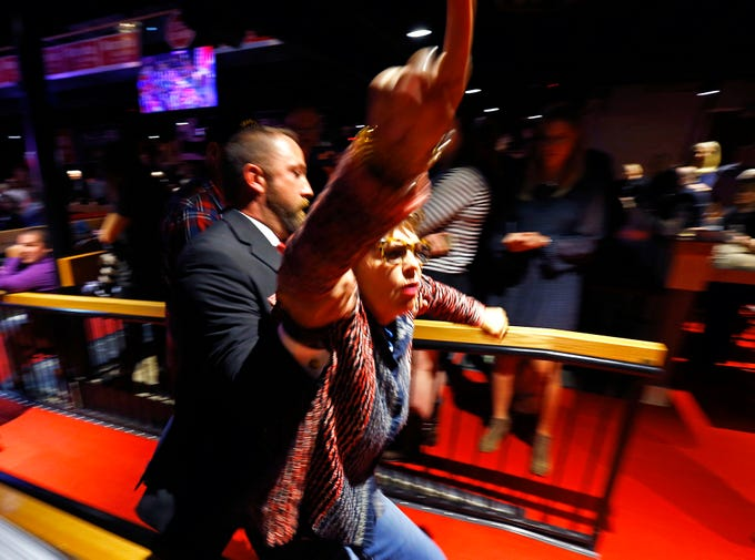 A protester is taken from a campaign event for Republican U.S. Senate candidate Marsha Blackburn Sunday, Oct. 28, 2018, in Nashville, Tenn.