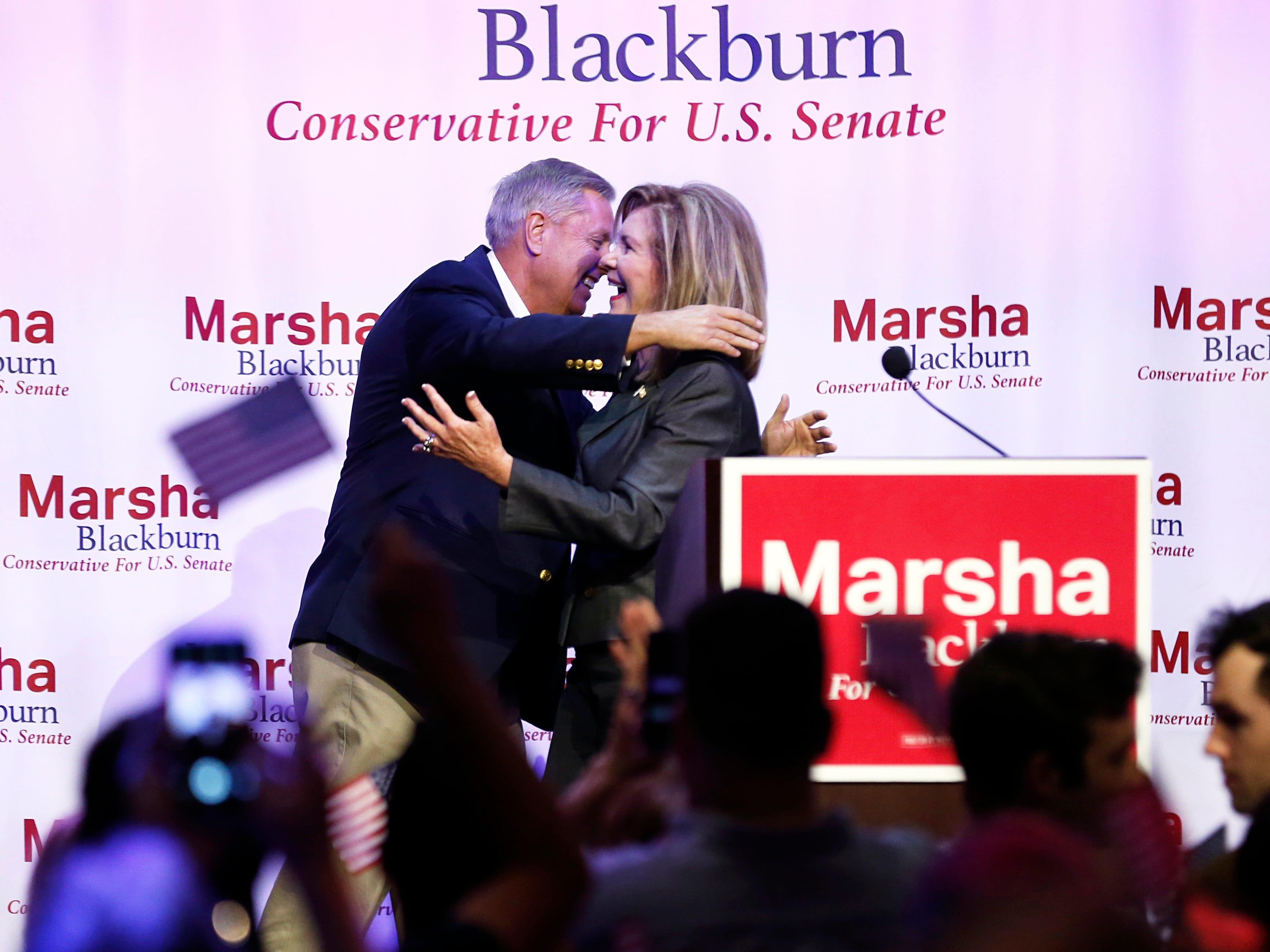 U.S. Sen. Lindsey Graham, R-S.C., hugs U.S. Rep. Marsha Blackburn during a campaign event for the Republican Tennessee U.S. Senate candidate Sunday, Oct. 28, 2018, in Nashville, Tenn.