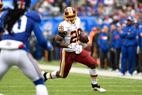 Washington Redskins running back Adrian Peterson (26) rushes against the New York Giants in Week 8 on Sunday, Oct. 28, 2018, in East Rutherford.