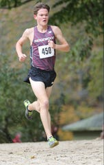 Will Baginski, of Ridgewood, is shown near the midway point of the race.  Baginski came in third place with a time of 15:53.  Ridgewood went on to take the team title.   Sunday, October 28, 2018