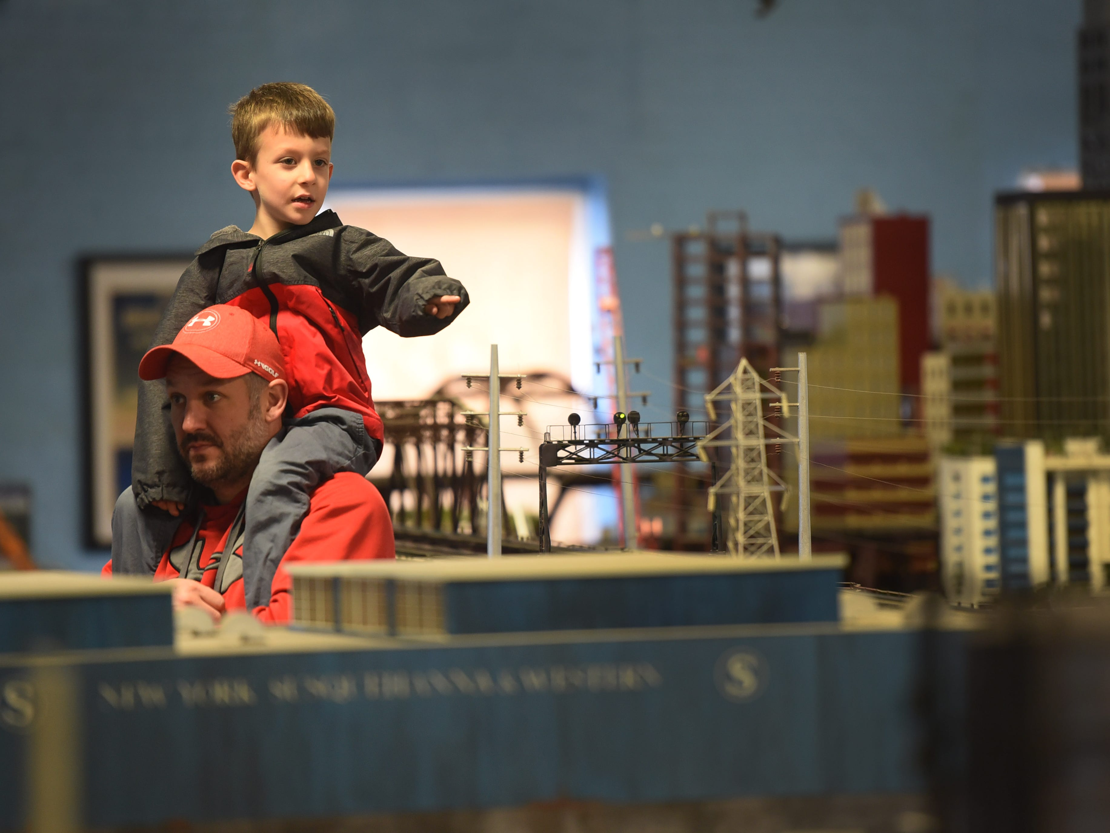 Four-year-old Grady McKee of Glen Rock, thanks mainly to his father Ryan, has a great perch to see the massive model train layout in Paterson on Oct. 28. The show was held by the NJ Hi-Railers Club.