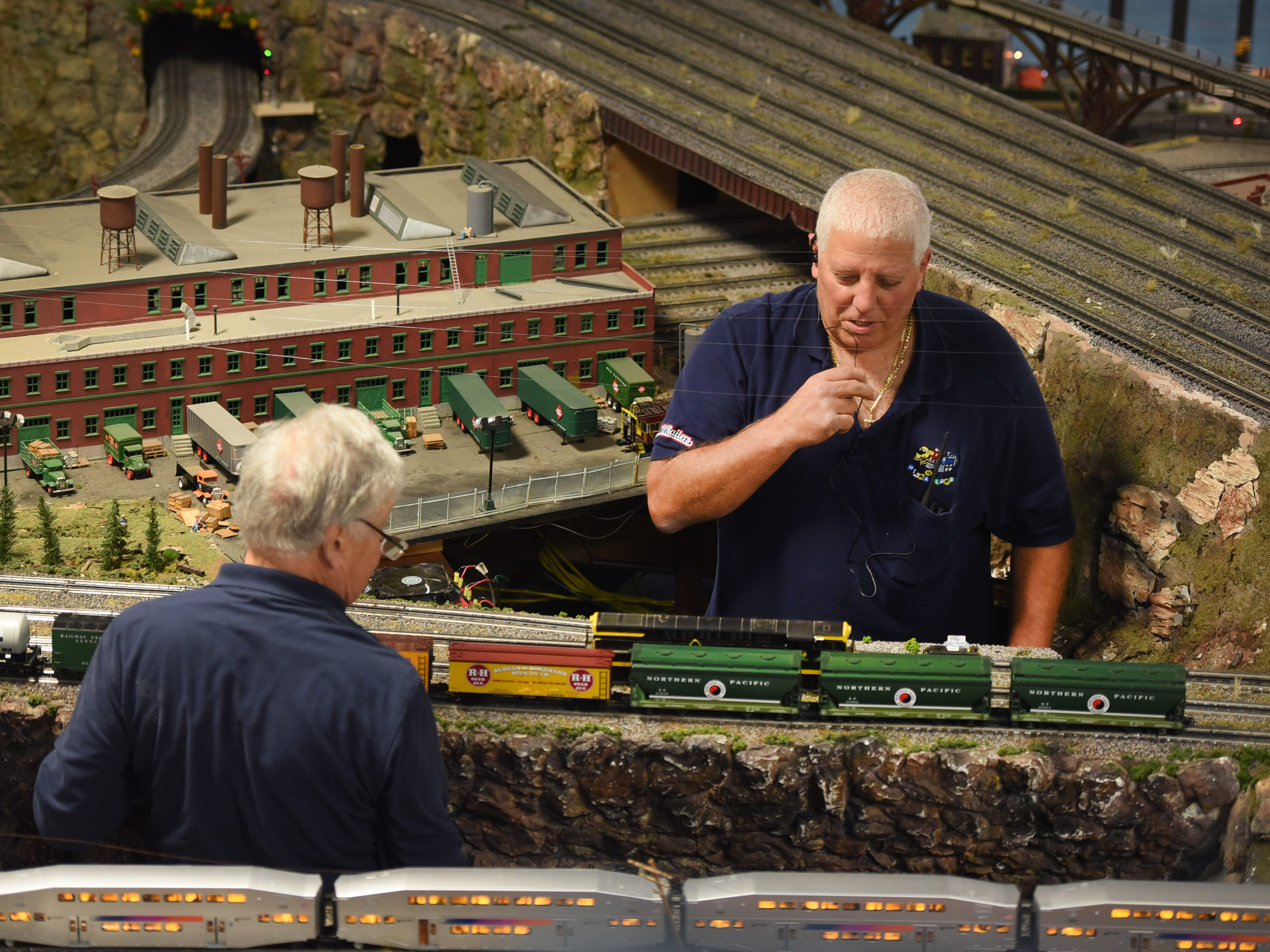 Ben Fioriello (R), President of the NJ Hi-Railers club, checks the display as the club holds a periodic show for the public at Silk City Station in Paterson on 10/28/18.