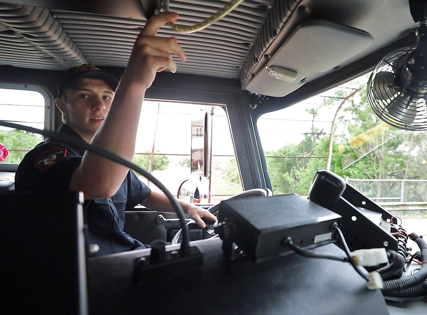 This Mingo Junction firefighter is 18 year old John Wright Jr. Here he drives the fire truck and pulls the horn. This was his last day of high school and he talks fondly of his love for his hometown of Mingo Junction regardless of the difficulties the town has and continues to face.