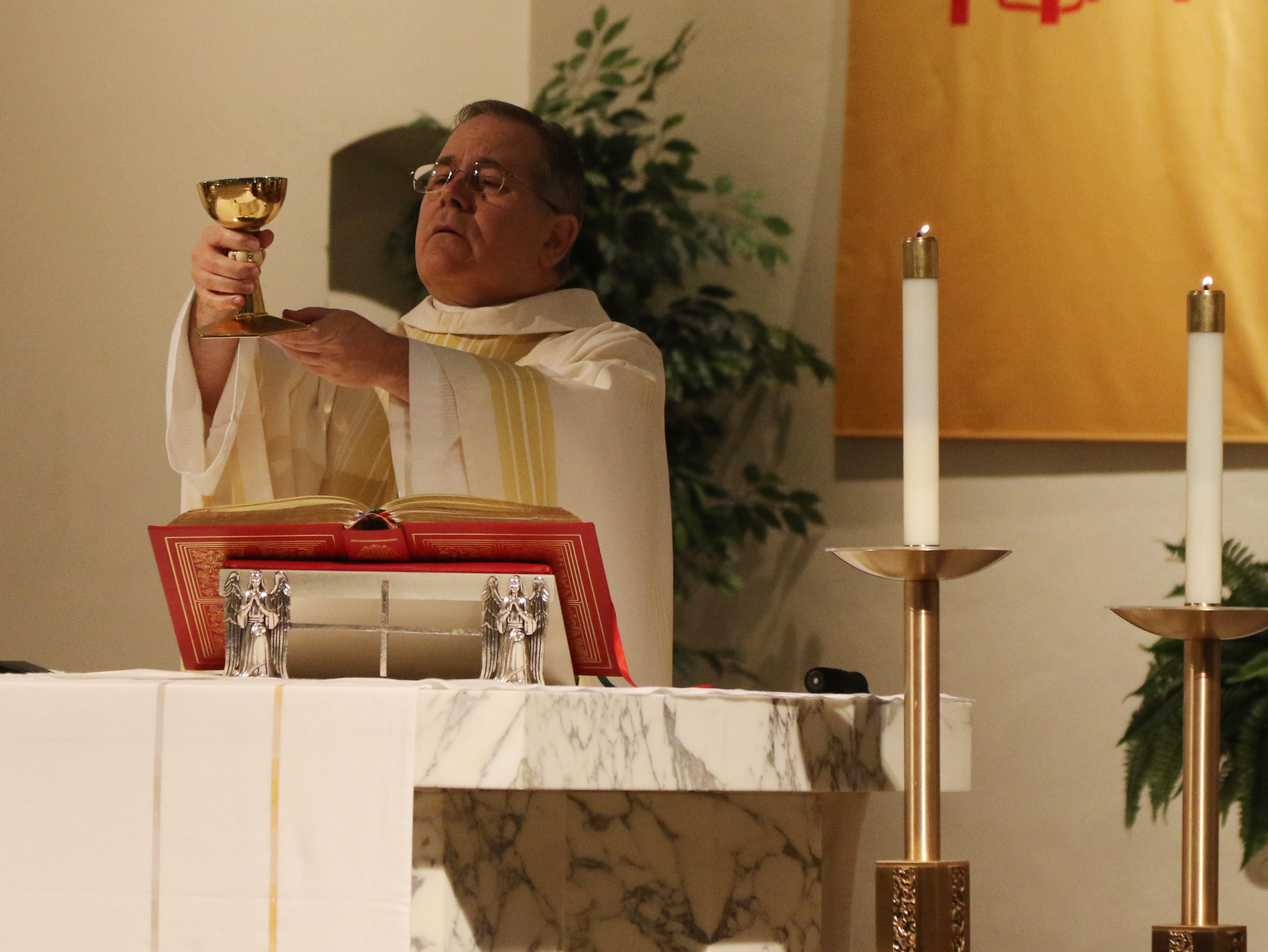 Father James Dunfee says Mass at the 8 am services at St. Agnes Church in Mingo Junction.