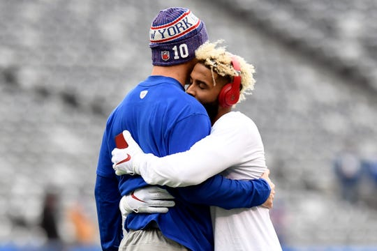 New York Giants quarterback Eli Manning, left, and wide receiver Odell Beckham Jr. hug before facing the Washington Redskins in Week 8 on Sunday, Oct. 28, 2018, in East Rutherford.