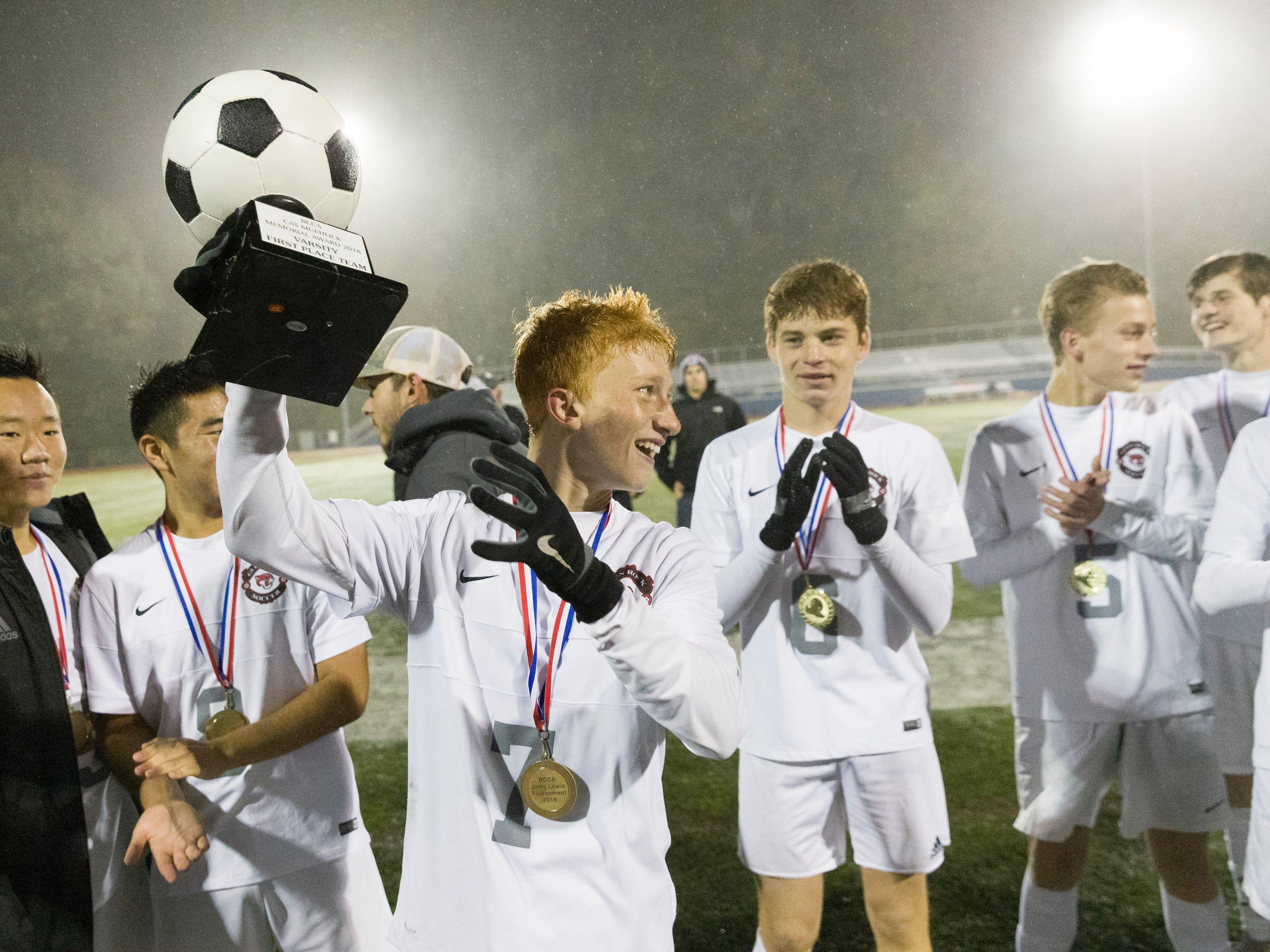 OAKLAND, NJ 10/27/2018  Glen Rock's Ben Zakowski (7) raises the trophy after his team's 3-0 victory over Ramsey in Saturday night's Bergen County Boys High School Soccer Tournament final.
